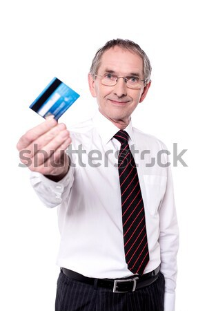 Cropped image of a man showing credit card Stock photo © stockyimages