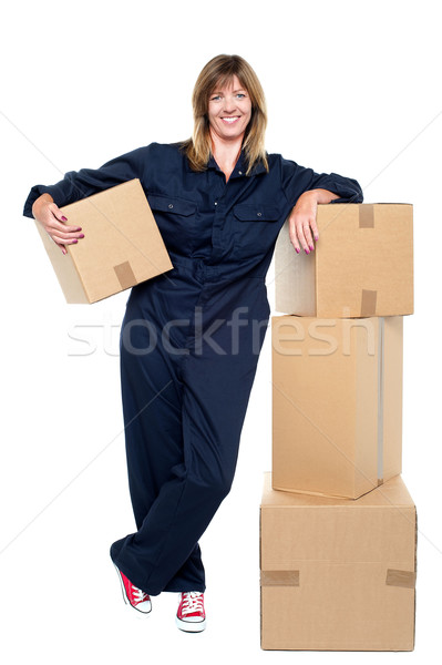 Charming woman in uniform posing with cartons Stock photo © stockyimages