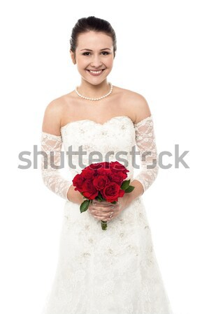 Bride offering her token of love to the groom Stock photo © stockyimages