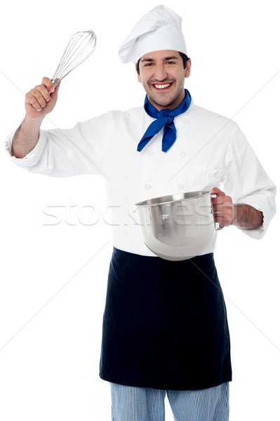 Smiling chef showing kitchen essentials Stock photo © stockyimages