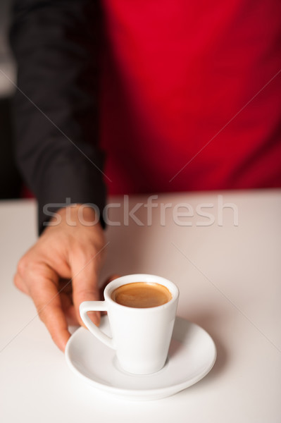 Hands of waiter serving a cup of cappucino Stock photo © stockyimages