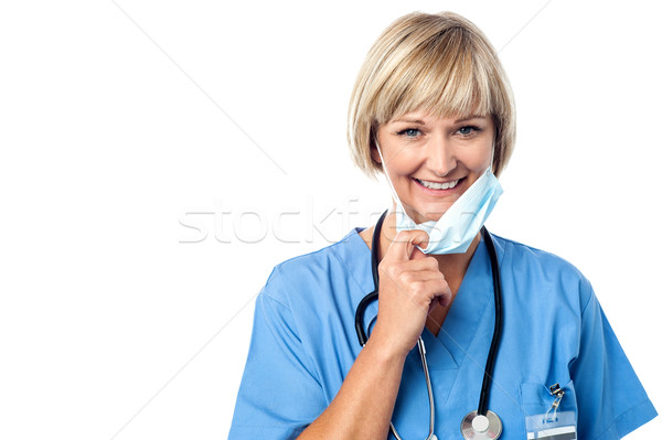 Female doctor takes off his mask Stock photo © stockyimages