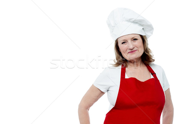 Aged female chef posing in style Stock photo © stockyimages