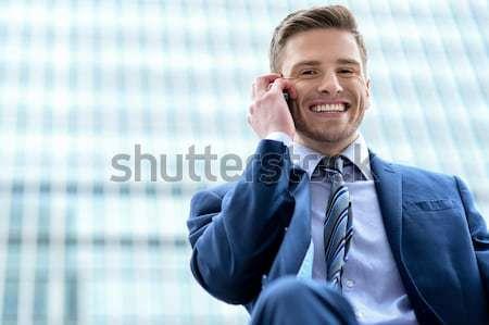 Souriant Homme professionnels parler téléphone portable élégant Photo stock © stockyimages