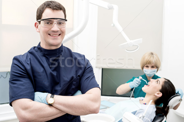 Assistant treating carious teeth of patient Stock photo © stockyimages
