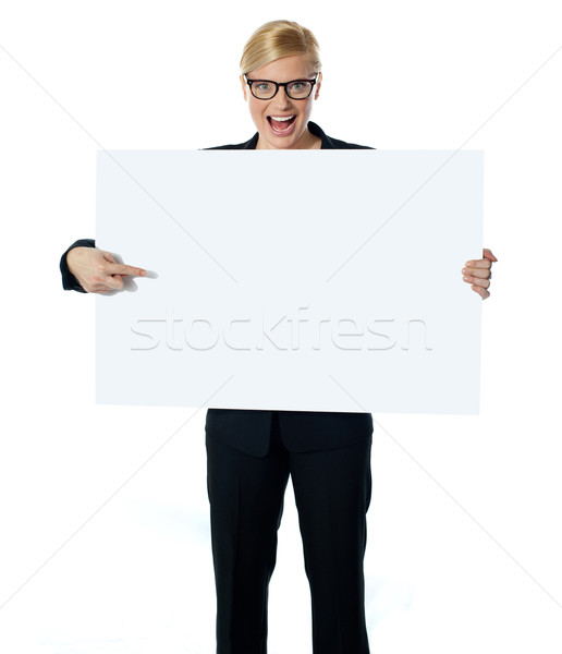 Saleswoman pointing at blank billboard Stock photo © stockyimages