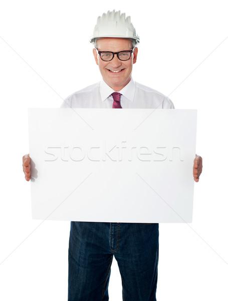 Senior architect holding blank billboard Stock photo © stockyimages