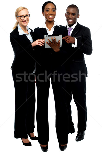 Technology savvy business team using tablet pc Stock photo © stockyimages