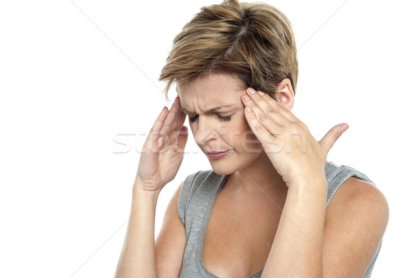 Woman having headache. Holding her head Stock photo © stockyimages