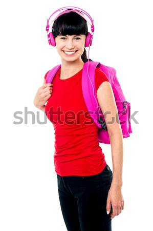 College teen dressed in casuals enjoying music Stock photo © stockyimages