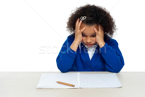 Stressed out primary girl child holding her head Stock photo © stockyimages