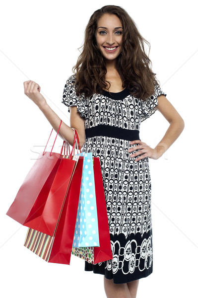 Shopaholic brunette carrying vibrant color bags Stock photo © stockyimages