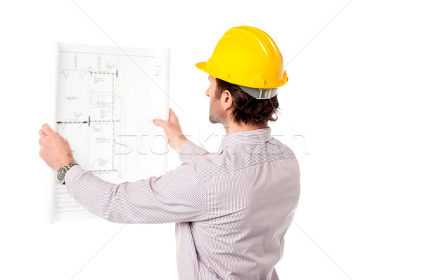 Architect reviewing building plan Stock photo © stockyimages