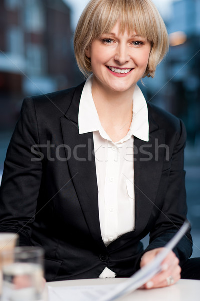 Business women reviewing business report Stock photo © stockyimages