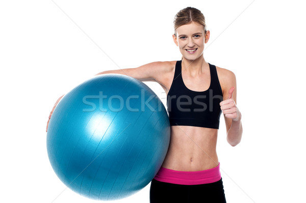 Fitness girl with aerobic ball  showing thumbs sign Stock photo © stockyimages