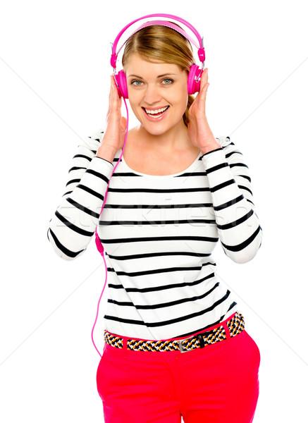 Beautiful electro pop girl enjoying music Stock photo © stockyimages