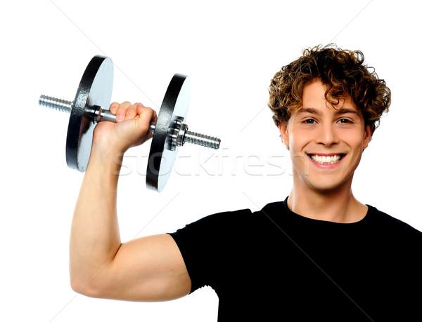 Potente muscular joven peso sonriendo Foto stock © stockyimages