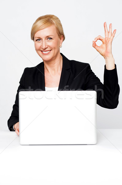 Happy businesswoman gesturing okay sign Stock photo © stockyimages