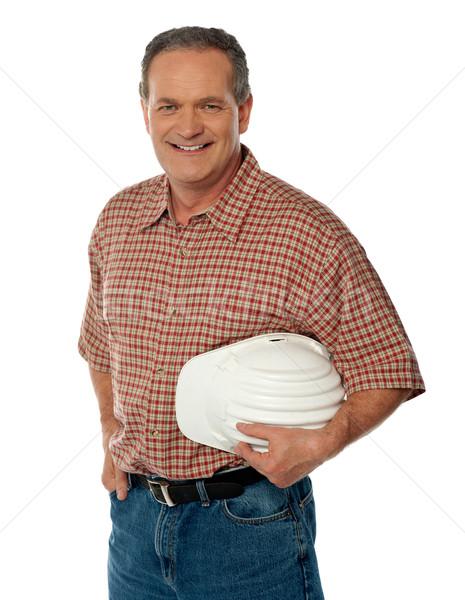 Smiling senior architect holding white safety hat Stock photo © stockyimages