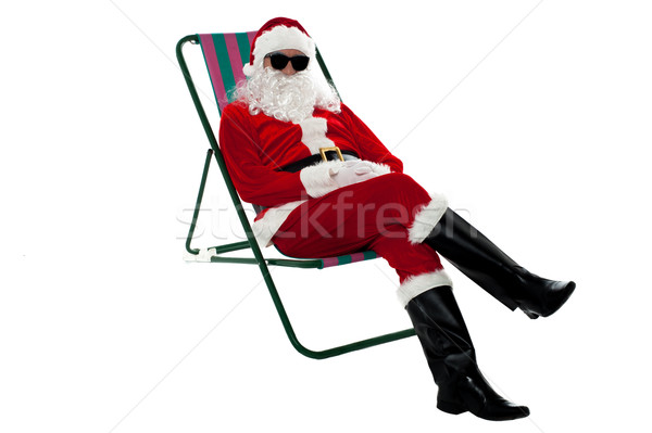 Santa wearing shades and striking stylish pose Stock photo © stockyimages