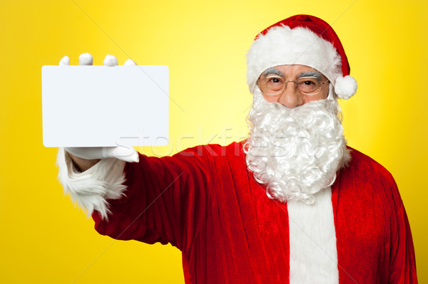 Saint Nick flashing a blank placard to the camera Stock photo © stockyimages
