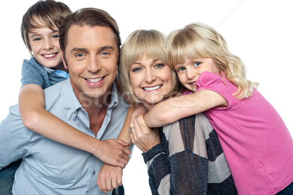 Happy family of four members posing together Stock photo © stockyimages