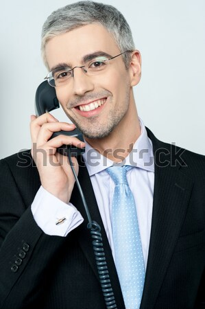 Customer support executive posing confidently Stock photo © stockyimages