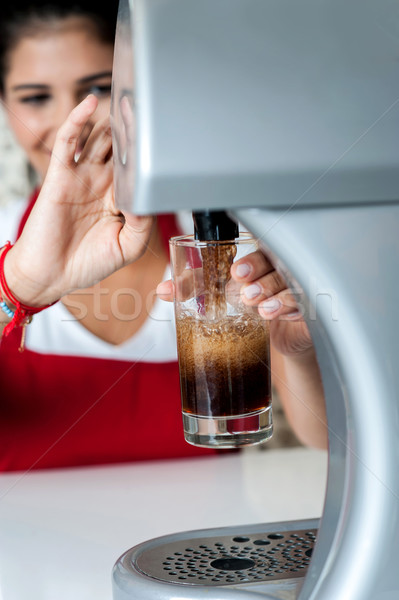 Girl filling glass with chocolate shake Stock photo © stockyimages