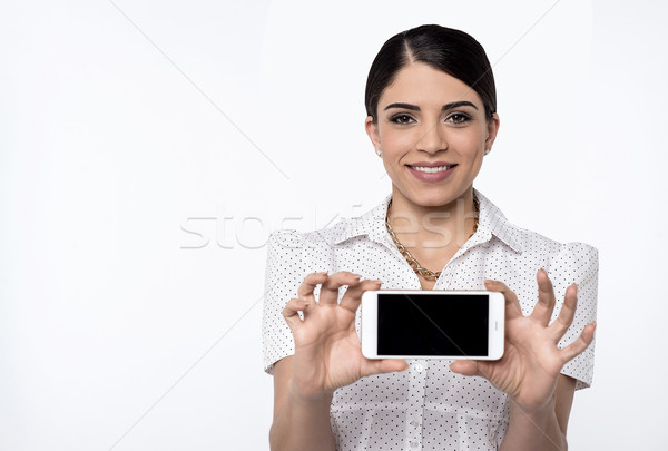 Brand new cellphone is out for sale. Stock photo © stockyimages