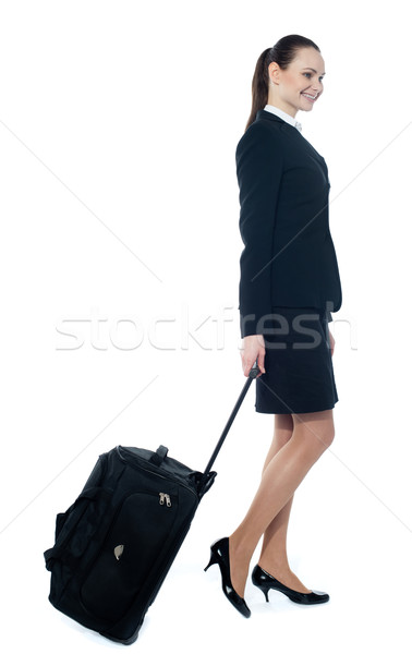 American tourist dragging her trolley bag Stock photo © stockyimages
