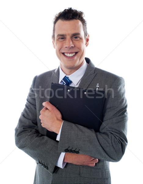 Happy businessman holding a clipboard Stock photo © stockyimages
