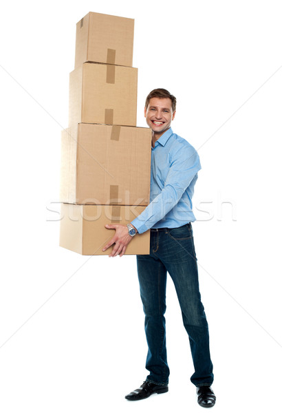 Young man with stack of cartons Stock photo © stockyimages