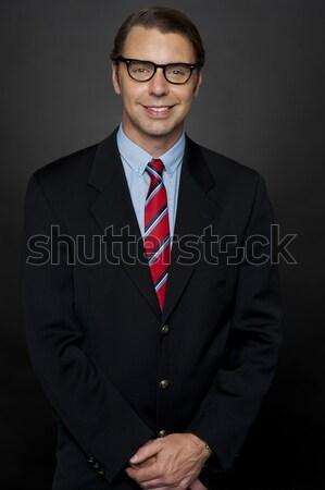 Portret geslaagd jonge zakenman geïsoleerd helling Stockfoto © stockyimages