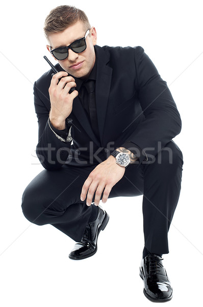 Security officer communicating and investigating Stock photo © stockyimages