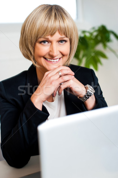 Attractive blonde business executive posing Stock photo © stockyimages
