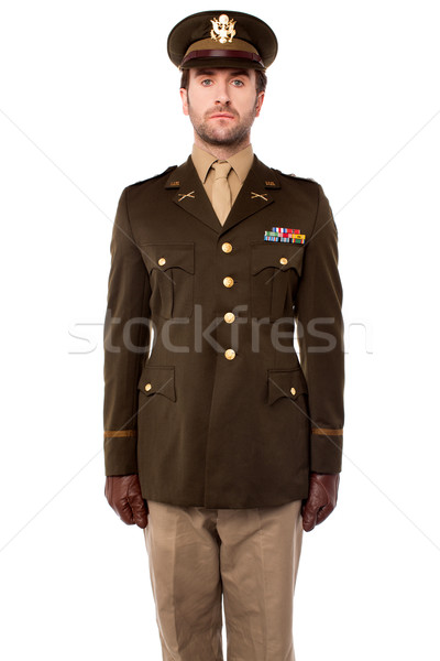 Young military officer in attention position Stock photo © stockyimages