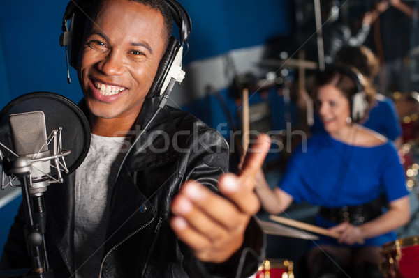 Young man singing in studio Stock photo © stockyimages