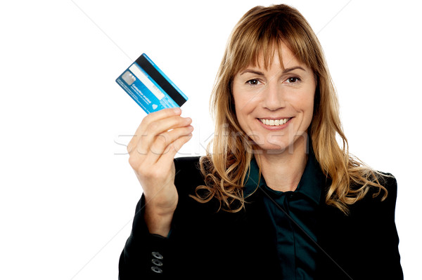 Businesswoman displaying cash card Stock photo © stockyimages