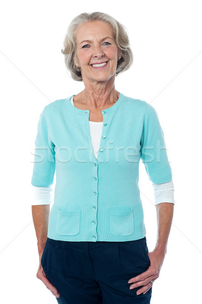 Old lady posing casually, full length portrait. Stock photo © stockyimages