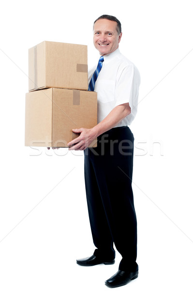 Stock photo: Smiling mature man carrying boxes