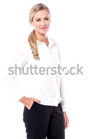 Smiling woman posing casually Stock photo © stockyimages