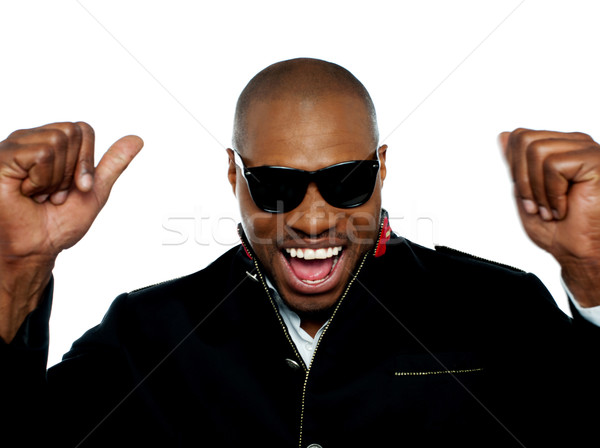 Portrait of excited young african man Stock photo © stockyimages