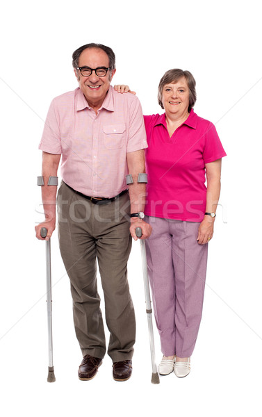 Woman supporting her handicapped husband Stock photo © stockyimages