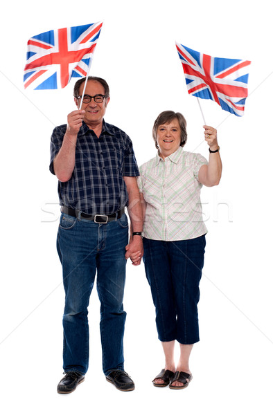 Senior citizens supporting their nation Stock photo © stockyimages
