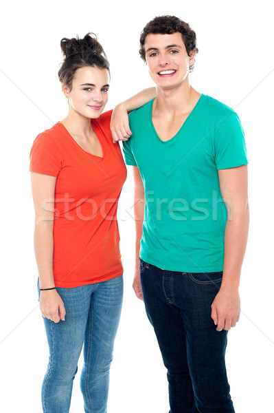 Adorable teenage couple in casuals Stock photo © stockyimages