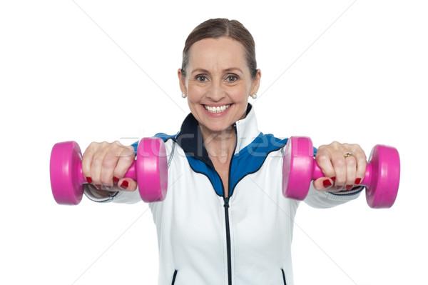 Vrouwelijke roze armen handen Stockfoto © stockyimages