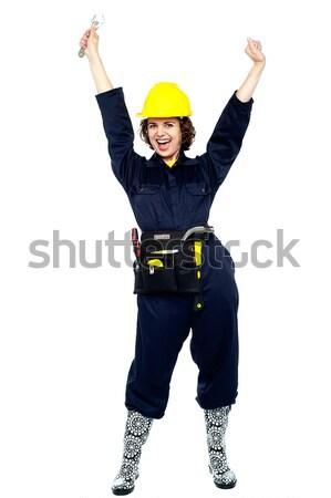 Craftswoman celebrating her success Stock photo © stockyimages
