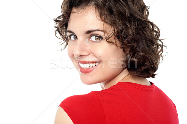 Pretty model turnimg back and smiling Stock photo © stockyimages
