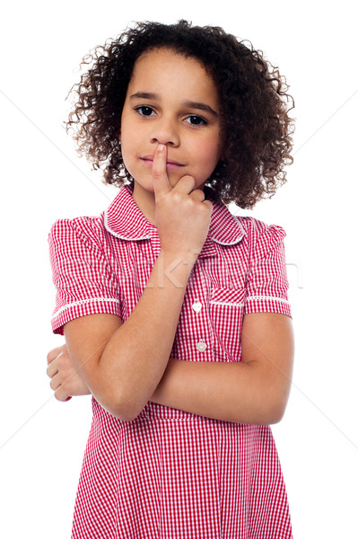 Pretty african american gesturing silence Stock photo © stockyimages