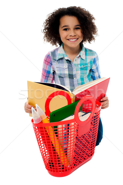 Elementary age school girl reading a book Stock photo © stockyimages